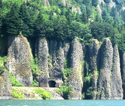 volcanic columns with train tunnel